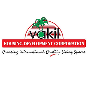 Who is Vakil Housing Development Corporation?