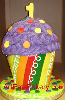 Giant cupcake 1st birthday cake with purple icing stripes and polka dots
