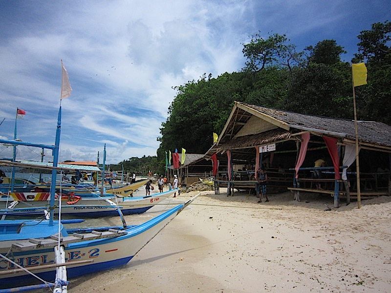 bangkas and eating places on a beach in Boracay