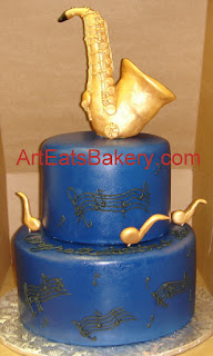 Colbalt blue fondant two tier custom birthday cake with sugar music notes and saxaphone