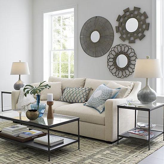 Son tendencia los espejos sol for Decoracion encima sofa