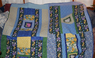 Back of Jean's quilt with photos of flowers from her garden