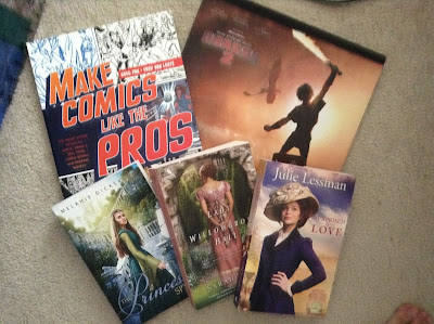 Books pictured: Make Comics Like the Pros. The Art of How to Train Your Dragon 2, The Princess Spy, A Lady at Willogrove Hall, Surprised by Love.