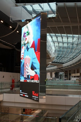 Poster inside of the Westfield Stratford City shopping center in London England
