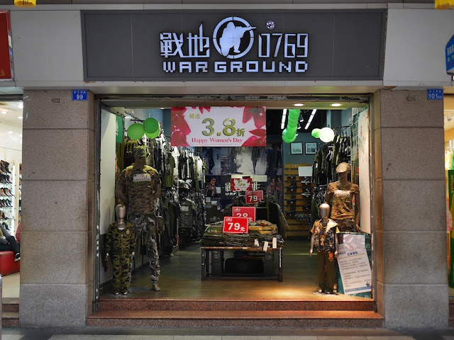 Warground store in Zhongshan with a Happy Women's Day sale sign