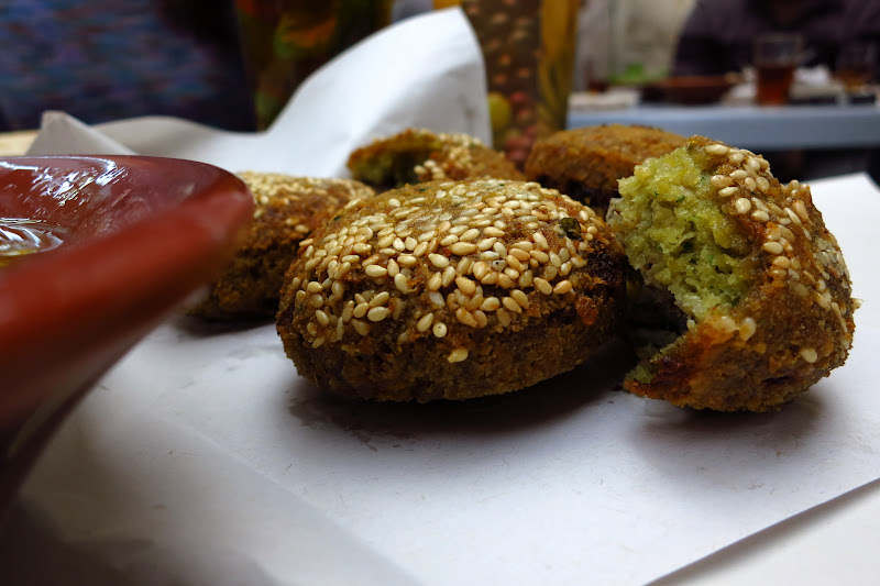 Falafel... stuffed with roasted onions and rolled in toasted sesame seeds.
