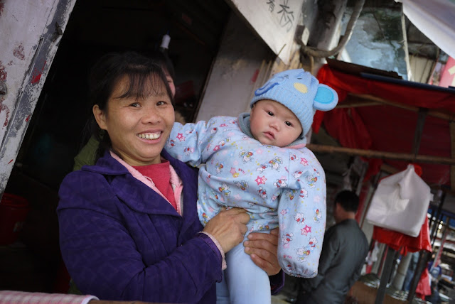 a woman holding a baby in Changsha, China