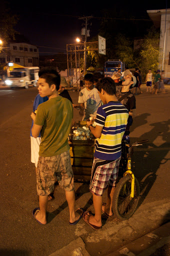 People buy and sell balut from the back of a bike in Cebu City, Philippines. Photo by Bobbi Lee Hitchon