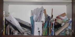 cluttered cupboard