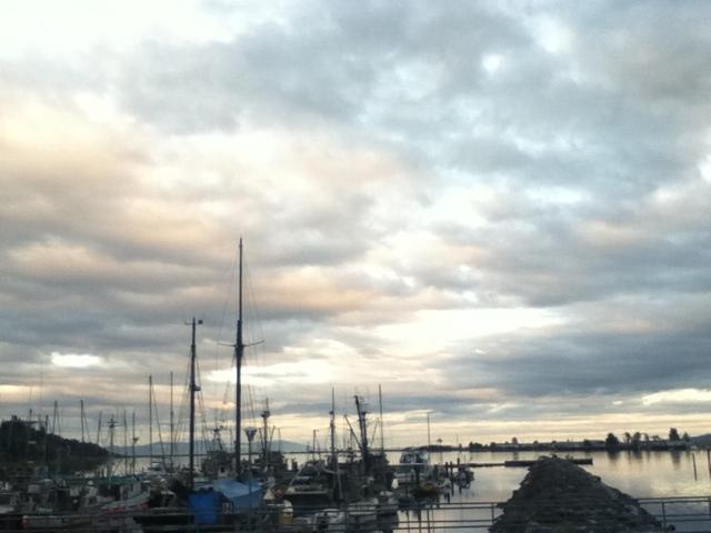 Sunset on clouds above Comox Marina