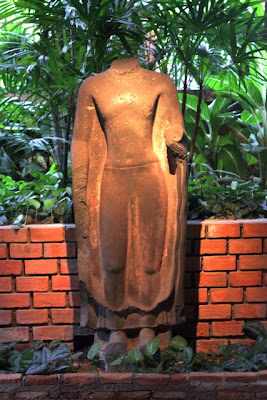 Sculpture of the Buddha at the Jim Thompson House museum in Bangkok Thailand