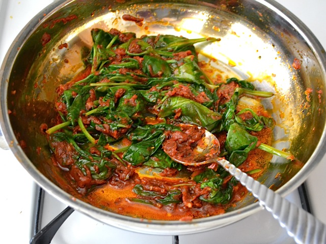 spinach added to sauce in skillet