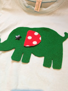 deciding where on the tshirt, the elephant will go, what direction, where his ear should be.