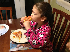 Matilda isn't shy about digging in to her pizza