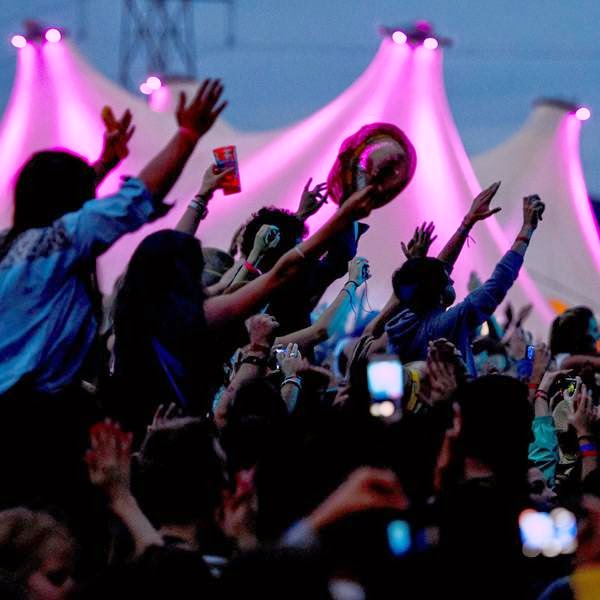 Festival goers gesture during a concert on the opening day of the 39th Paleo Festival Nyon on July 22, 2014 in Nyon, Switzerland.