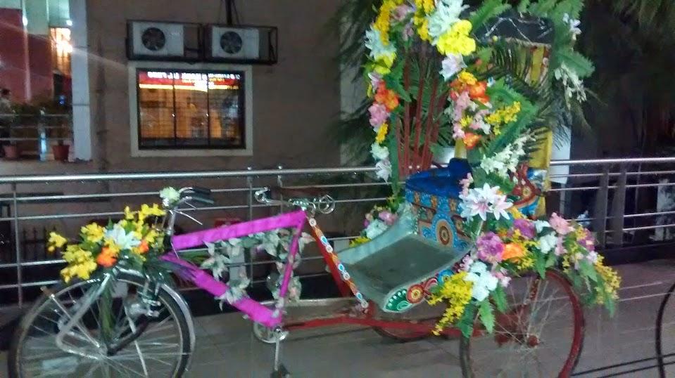 Flower decked Auto Rickshaw - Malaka Spice