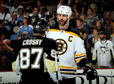 Sidney Crosby #87 of the Pittsburgh Penguins and Zdeno Chara #33 of the Boston Bruins exchange words near the end of the second period