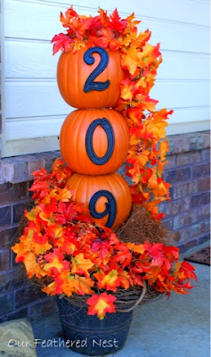 outdoor fall decorating, pumpkins, leaves, house number pumpkins