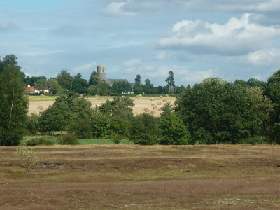 Royden Church viewed from across the Waveney Valley with its interesting octagonal upper tower that sits on a round base