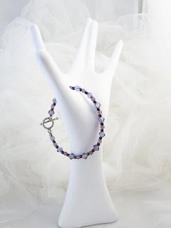 "Starlight - Purple crystals & glass beads  7 1/4""  $12"