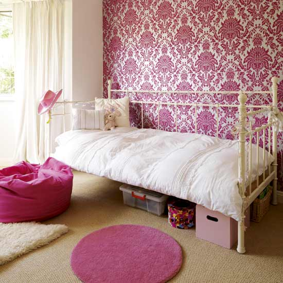 The bold magenta damask is suddenly fresh and modern when used on an accent  wall in an otherwise all white room. magenta pink burgundy rooms bedroom living room dress scarlett