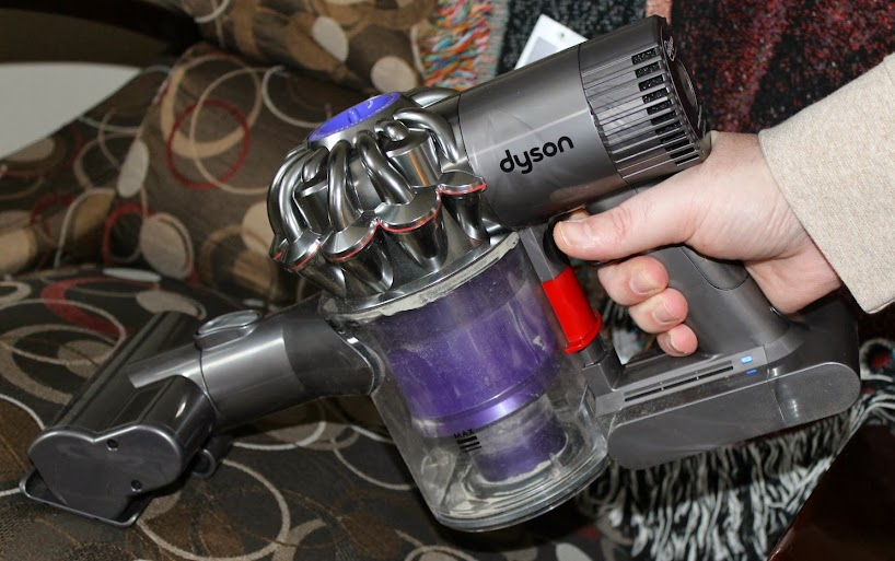 The Dyson DC59 Can Be Used in Hand-Held Mode for Upholstery and Other Small Jobs #DysonatBestBuy #BestBuyWOLF