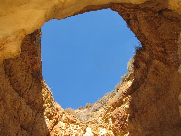 hole in the cave in portimao beach portugal