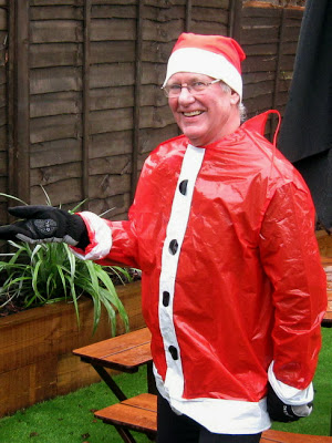 man in Father Christmas costume