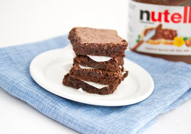 photo of a stack of Flourless Nutella Brownies on a plate
