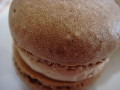Cocoa macarons with espresso buttercream