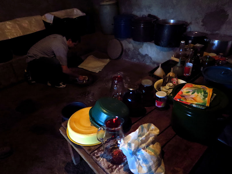 Scooping the wine from the kvevri