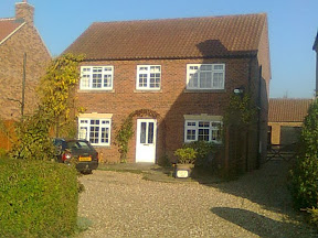 detached modern house with gravel frontage