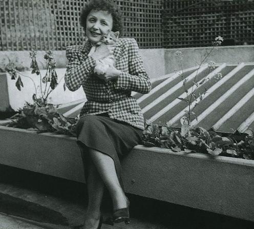 Edith Piaf holding a kitten