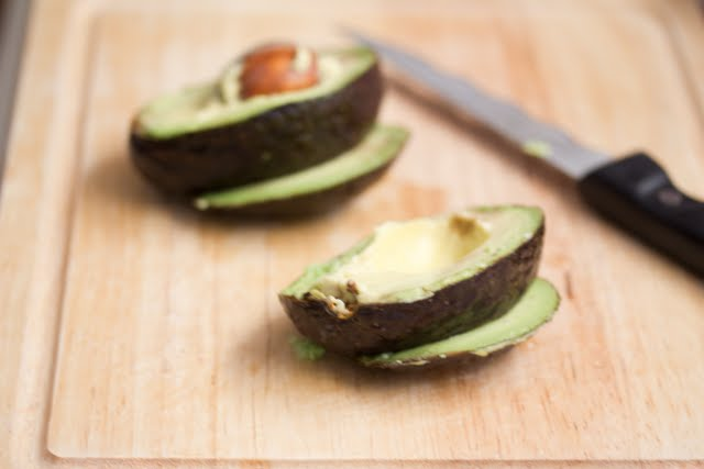 photo of an avocado sliced in half