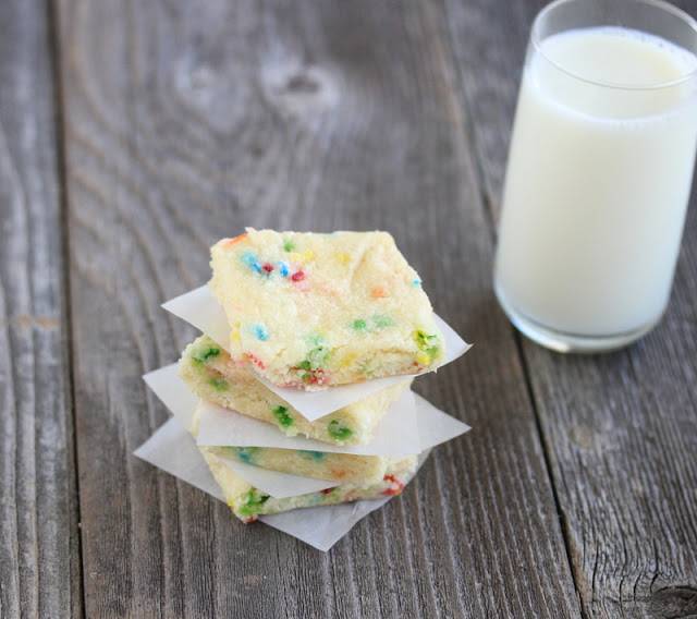 photo of a stack of Funfetti Brownies with a glass of milk