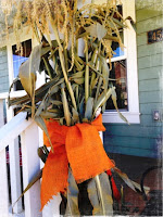 Cornstalks on porch, fall decor, the style sisters