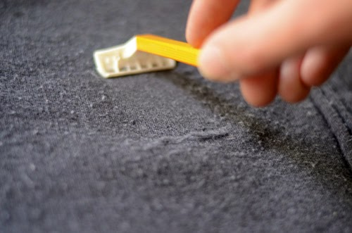 One of the best ways to depill winter coats and sweaters is by gently rubbing them with a pumice stone then removing them with a lint roller