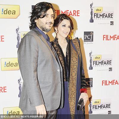 Sonali Bendre with husband Goldie Behl during the 58th Idea Filmfare Awards 2013, held at Yash Raj Films Studios in Mumbai.Click here for:<br />  58th Idea Filmfare Awards<br />