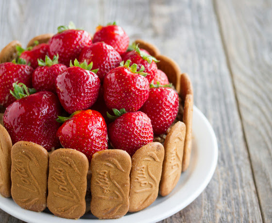 photo of a Biscoff Cake topped with fresh strawberries