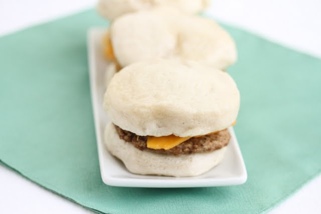 close-up photo of sausage sandwiches on a plate