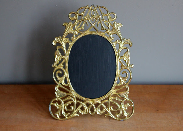 Ornate gold chalkboard available for rent from www.momentarilyyours.com, $2.00.