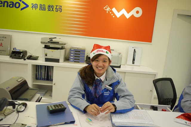 young woman wearing a Santa hat in Putian, China