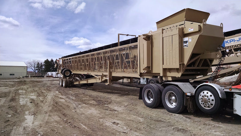 over-length conveyor trailer being hauled