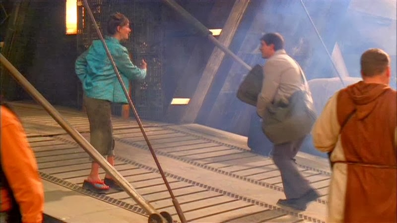 Screencap from the first episode of Firefly, showing the ramp entrance to Serenity