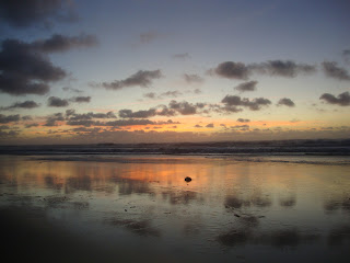 Sunset and sky reflected in a sea Photos - Sao Pedro de Moel
