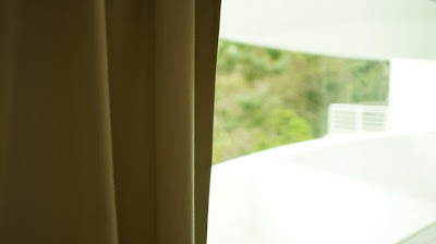 The room look out to the greenery outside. Some higher floor rooms has sea view.