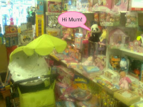 Precious Moments toy display dominated by Panda saying Hi Mum