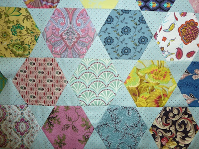 Brigitte giblin 39 s feathering the nest hexagon and blue for Hexagon quilt template plastic