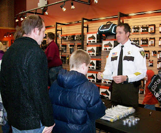 Sherburne County Sheriff Joel Brott shared info about child-safe gun locks with families at the event