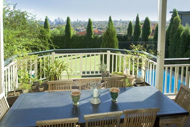 A cosy bowed verandah at 16 Bradleys Head Road Mosman